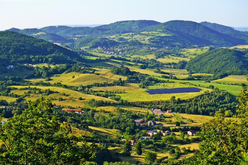Landscape with village and forest, Slovakia stock photography