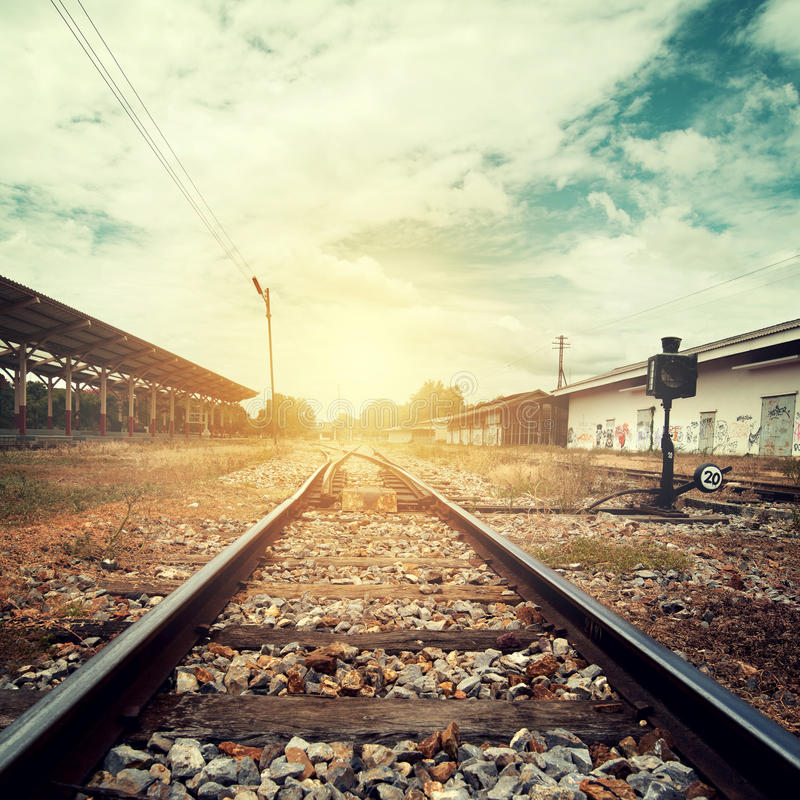 Landscape vintage of railroad tracks at train station royalty free stock photo