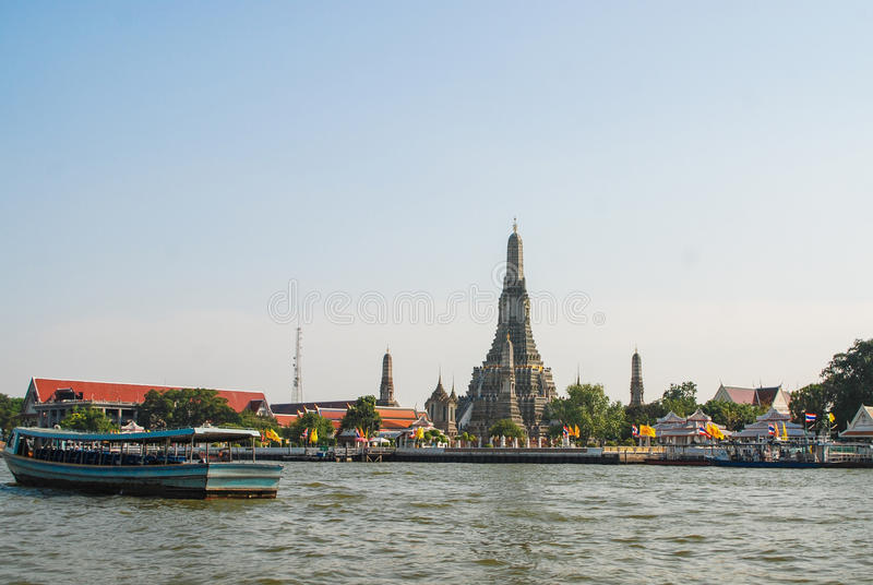 Landscape of Wat Arun. Wat Arun is among the best known of Thailand's landmarks and the first light of the morning reflects off the surface of the temple with stock photos