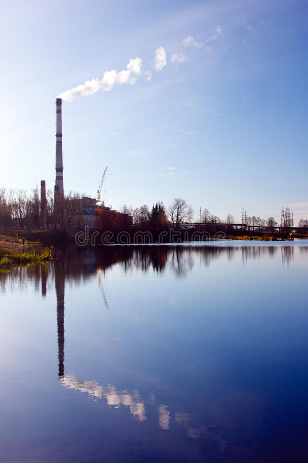 Landscape With Water And Smoking Chimneys Royalty Free Stock Images