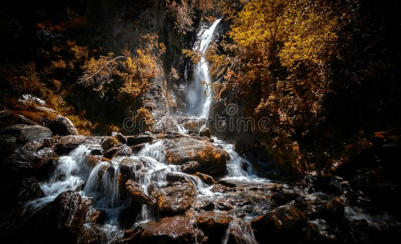 Landscape with waterfall of mountain Altai, Russia. Autumn, September royalty free stock photos
