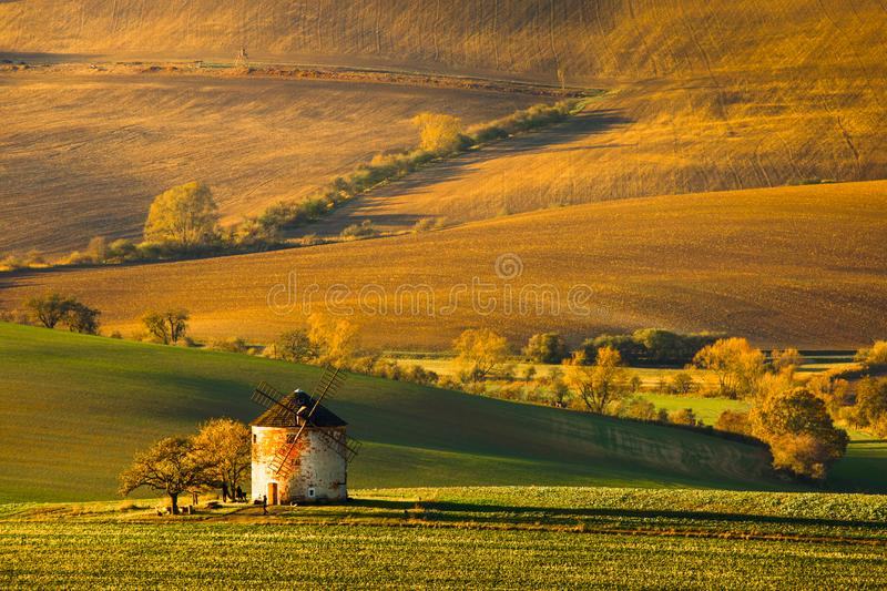 Andscape with waves hills, autumn fields with mill. South Moravia. Landscape with waves hills, autumn fields with mill. South Moravia, Czech Republic stock images