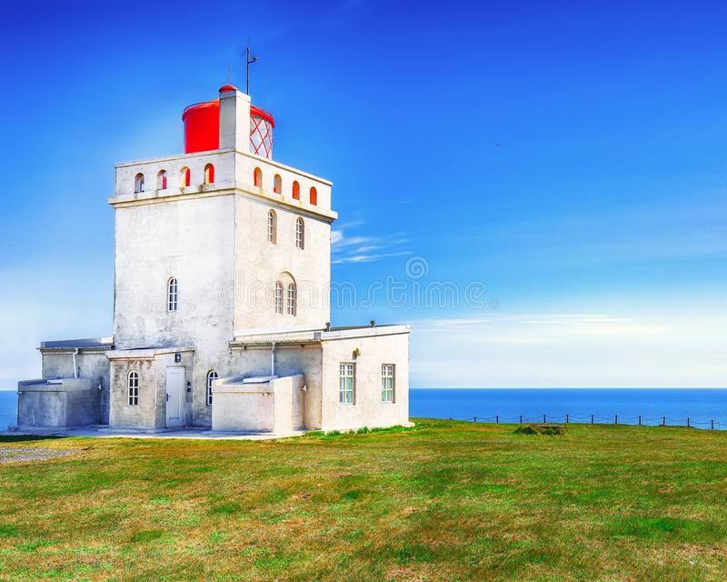 Landscape with white lighthouse at Cape Dyrholaey. Location: Cape Dyrholaey Cape Portland, near Vik village, Island, Europe stock photography