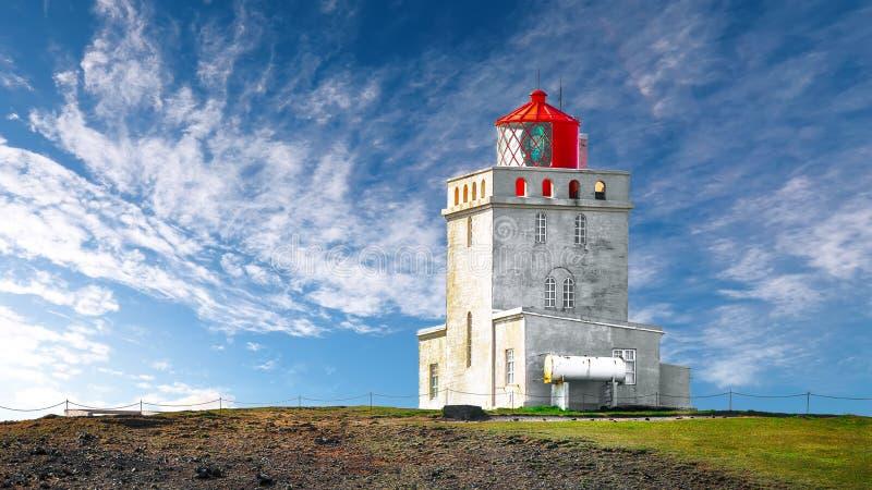 Landscape with white lighthouse at Cape Dyrholaey. Location: Cape Dyrholaey Cape Portland, near Vik village, Island, Europe royalty free stock images