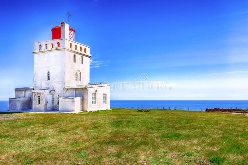 Landscape with white lighthouse at Cape Dyrholaey. Location: Cape Dyrholaey Cape Portland, near Vik village, Island, Europe stock photography