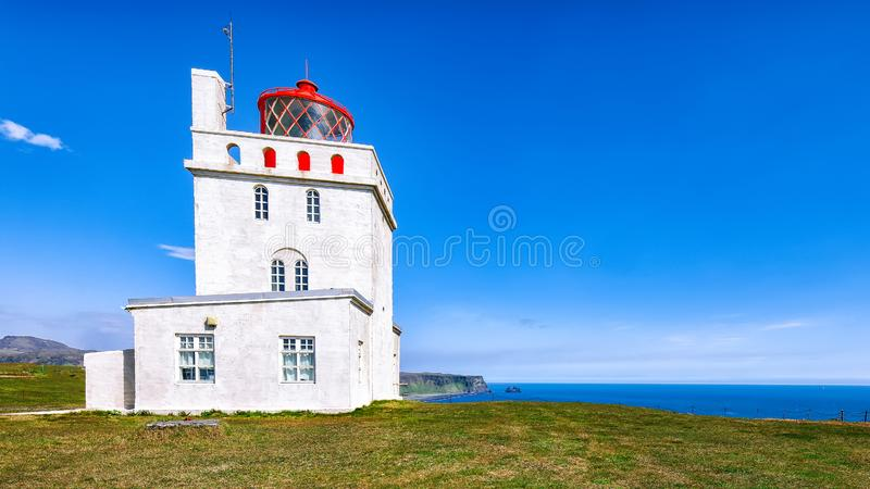 Landscape with white lighthouse at Cape Dyrholaey. Location: Cape Dyrholaey Cape Portland, near Vik village, Island, Europe stock photos