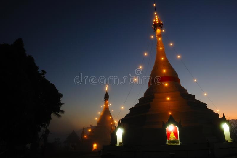 Landscape of white pagoda in twilight time stock photos