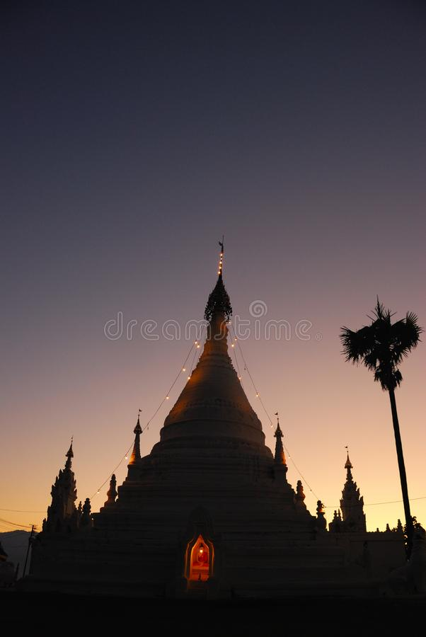 Landscape of white pagoda in twilight time stock images