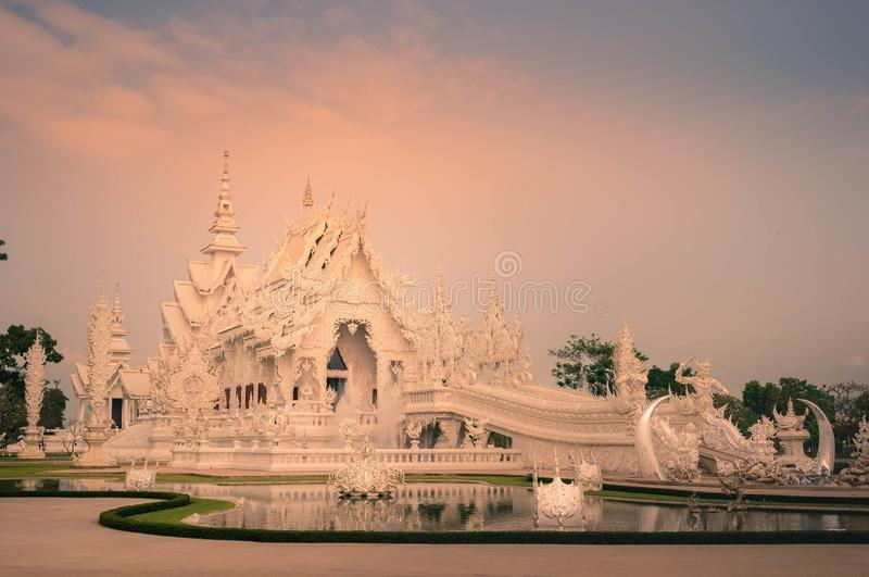 Landscape of White temple, Chiangrai  Thailand. Landscape of White temple in Chiangrai  Thailand that foreground with pond and background with cloud. The white stock photography