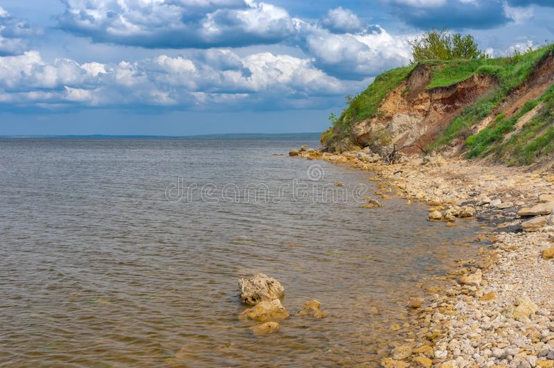 Landscape with wild beach on a hilly Kakhovka Reservoir located on the Dnipro River. Spring landscape with wild beach on a hilly Kakhovka Reservoir located on royalty free stock images