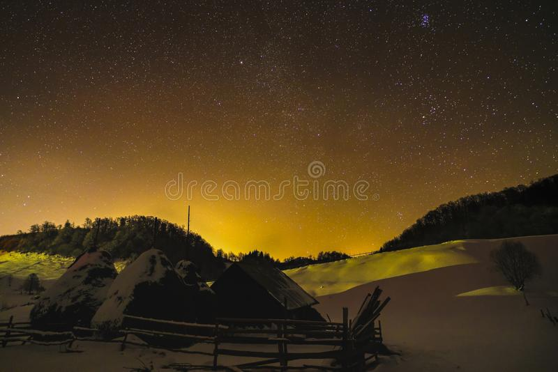 Landscape with winter night sky royalty free stock images