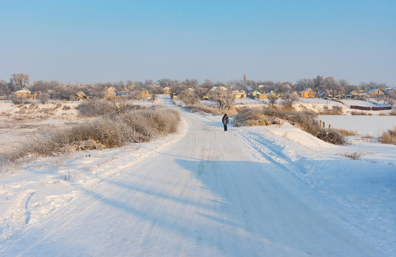 Landscape with winter street in urban-type settlement royalty free stock image