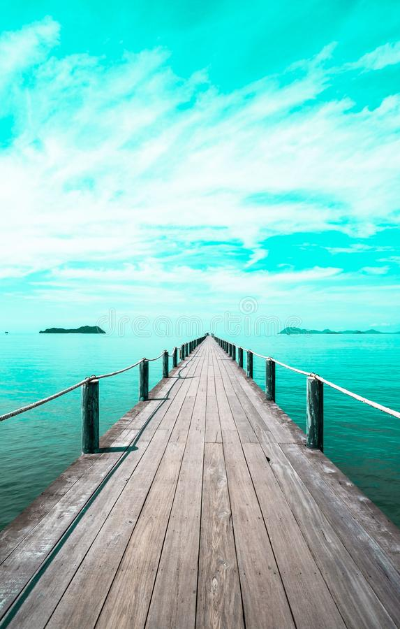 Landscape of wooden bridge in blue sea on tropical beach . vintage toned , Fashion, travel, summer, vacation and tropical beach. Creative made of Landscape royalty free stock images