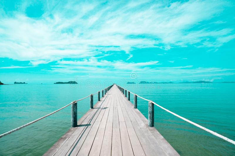 Landscape of wooden bridge in blue sea on tropical beach . vintage toned , Fashion, travel, summer, vacation and tropical beach. Creative made of Landscape stock image