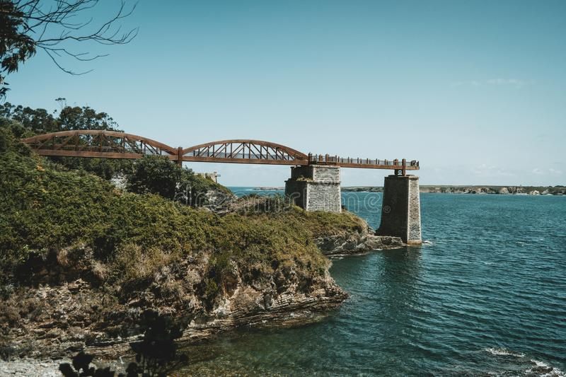 Landscape with a wooden bridge over the sea in ribadeo, spain stock images