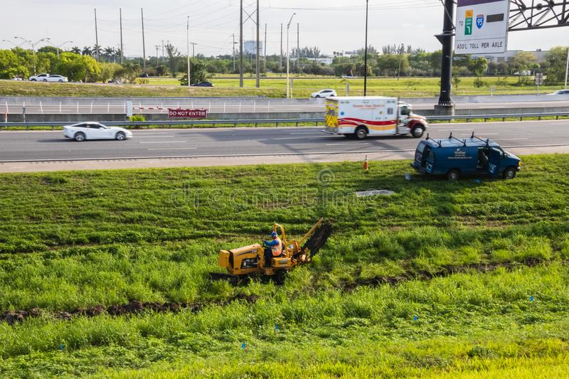 Landscape workers changing the grass on highway in Broward County stock photos