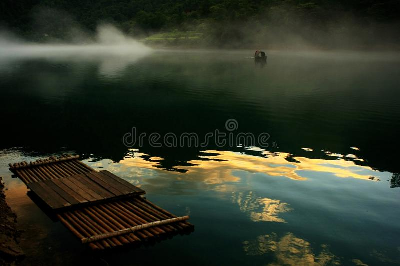 Landscape of Xiaodong River. Thousands of photographers descend on the 12-kilometer-long Xiaodong River every summer to capture the atmospheric fog. The surreal stock photo