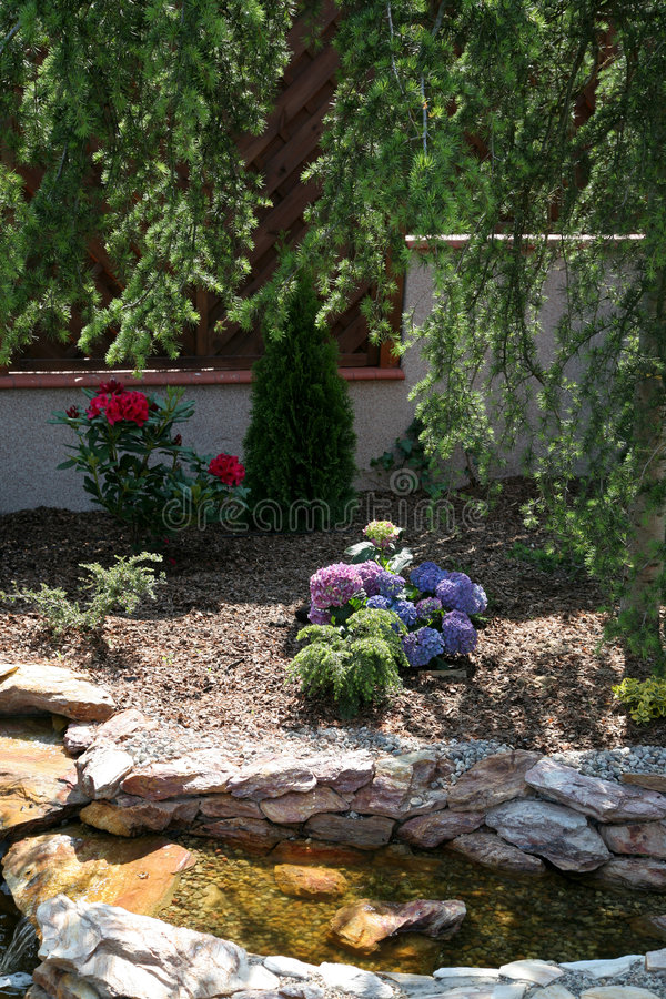 Landscaped domestic garden. Details of landscaped domestic garden with small water feature stock photography