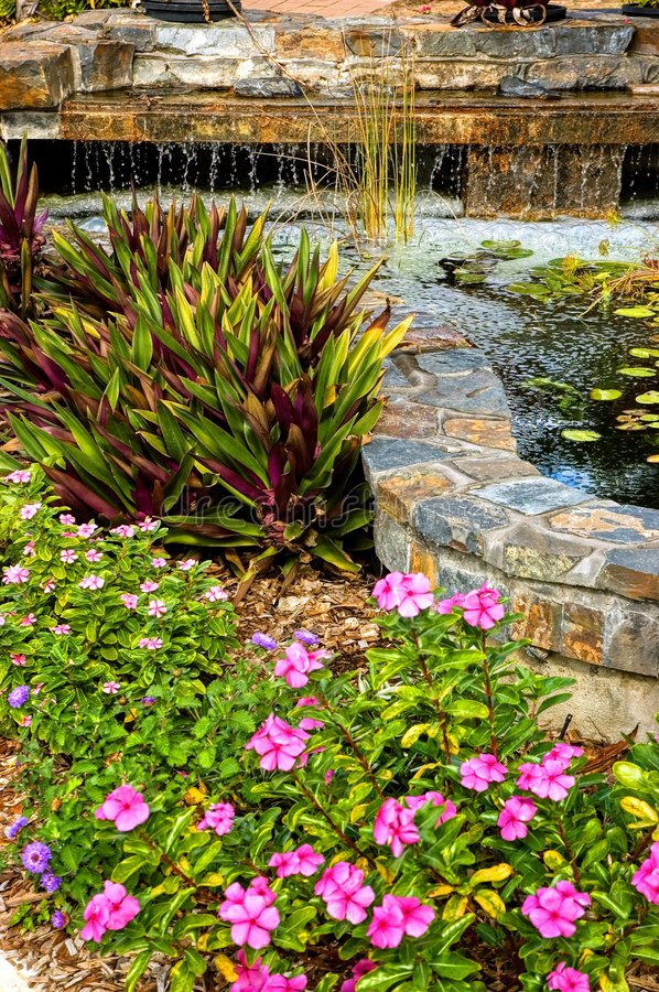 Landscaped garden with waterfall royalty free stock photos