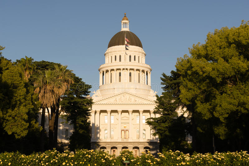Landscaped Grounds Downtown Sacramento California Capital Dome B. The flags and flowers fly in front of Sacramento's Capital Building stock photo