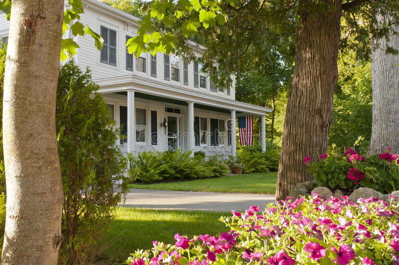 Landscaped house porch flowers stock image