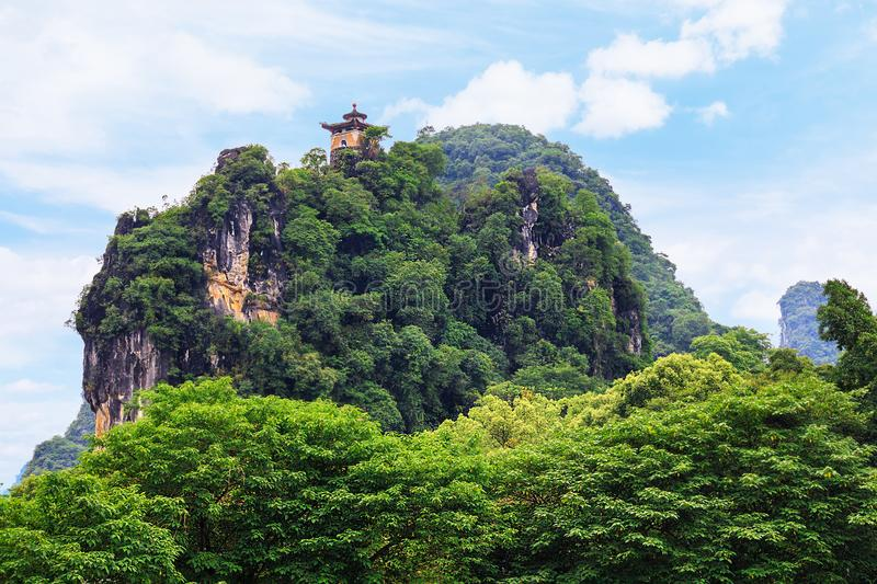 Traditional building in oriental style on the observation platform of the western mountain of Yangshuo Park stock image