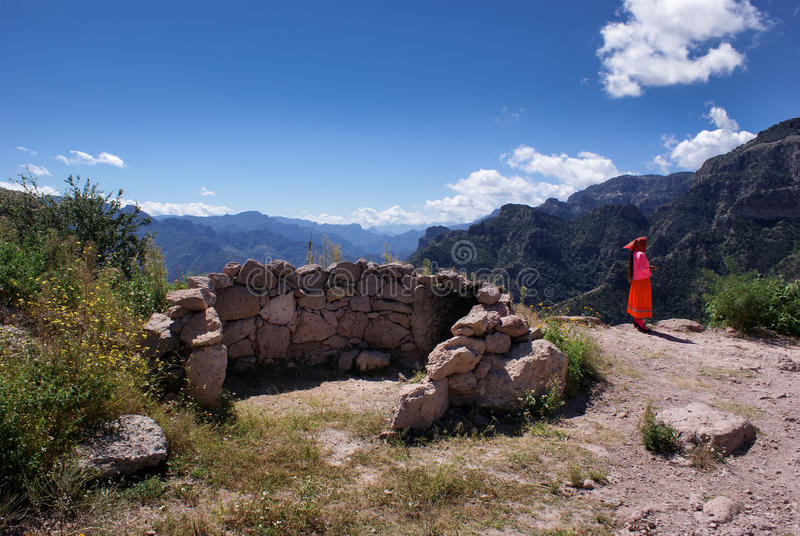Landscapes of Copper Canyons in Chihuahua, Mexico. Mountainous landscapes of Copper Canyons and indigenous Tarahumara woman in Chihuahua, Mexico stock image