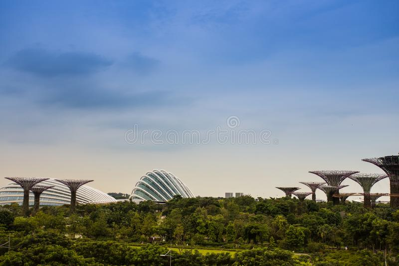 Afternoon sky at Garden By The Bay. The landscapes shows the garden by the bay in Singapore, with both of the flower dome and the forest dome, as well as all the royalty free stock photos
