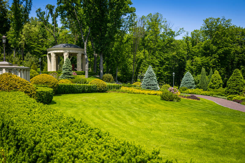 Landscaping in the garden. The path in the garden.Beautiful back royalty free stock images