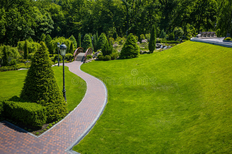 Landscaping in the garden. The path in the garden.Beautiful back royalty free stock photos
