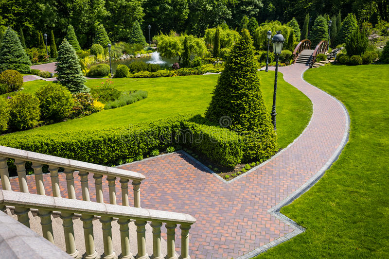 Landscaping in the garden. The path in the garden.Beautiful back royalty free stock image