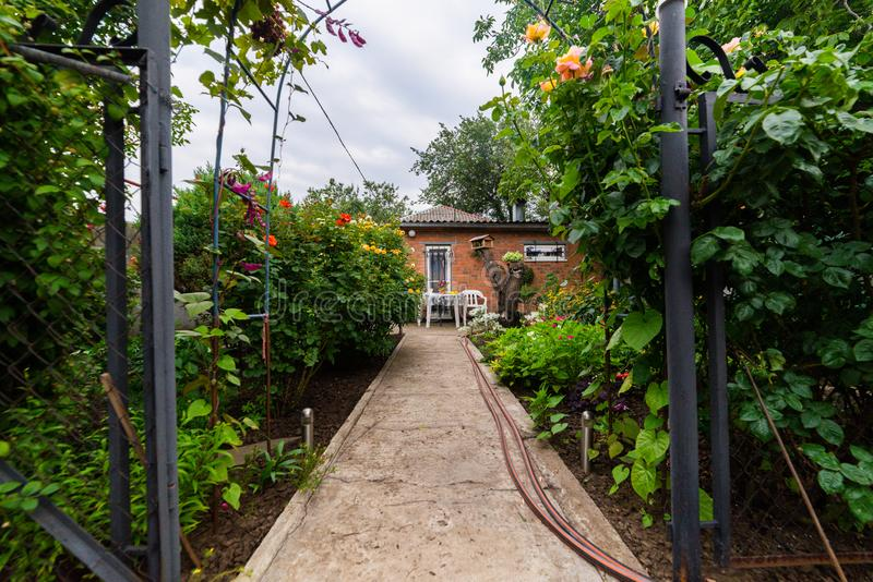 Landscaping in the garden. The path in the garden stock photography