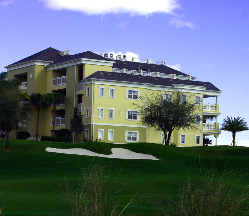 Landscaping at golf resort with yellow resort hotel stock photography