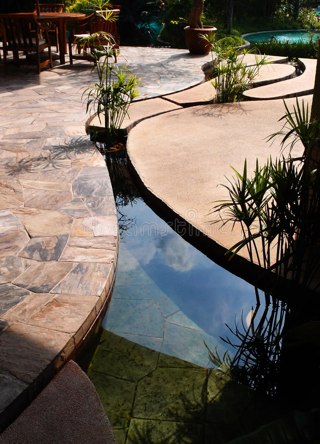 Landscaping - Tropical resort concrete pond royalty free stock photo