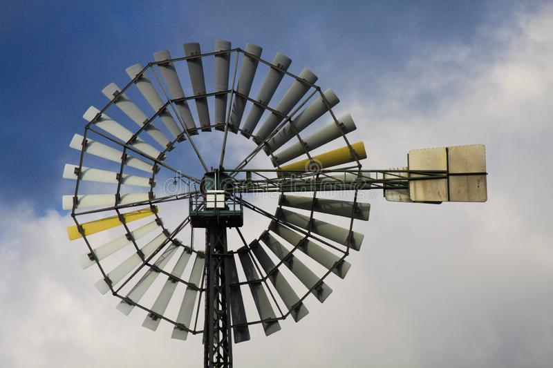 Landschaftspark Duisburg, Germany: Close up of isolated wind wheel against blue sky and clouds stock images