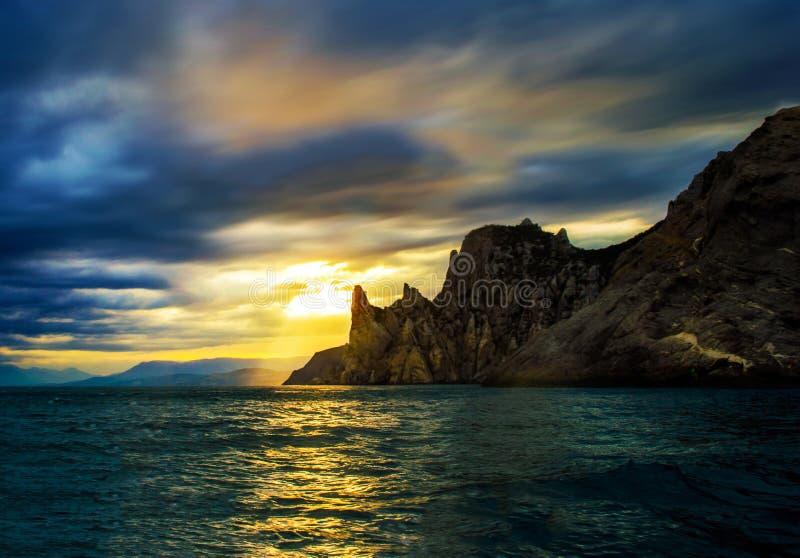 Landschaps overzeese zonsondergang stock afbeelding