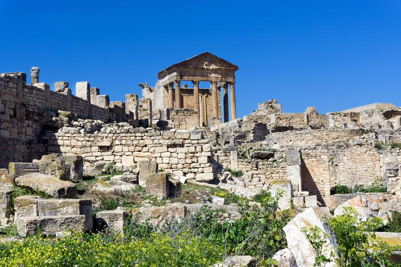 Ruins of the Capitol Building in Dougga, Tunisia. Landscpae of the capitol building in the ancient Roman ruins of Dougga, Tunisia royalty free stock image