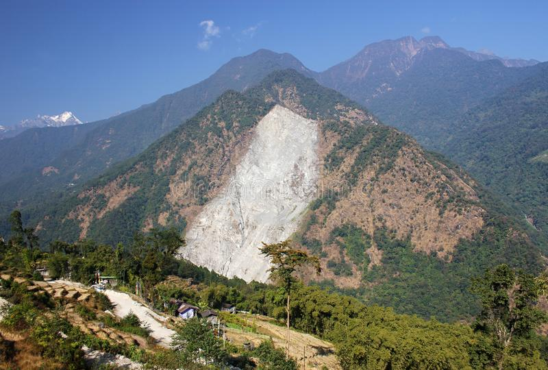 Landslide in the Himalayan mountain. A huge patch of mountain is washed away in a gigantic landslide. Several villages were destroyed in the catastrophic event royalty free stock photography