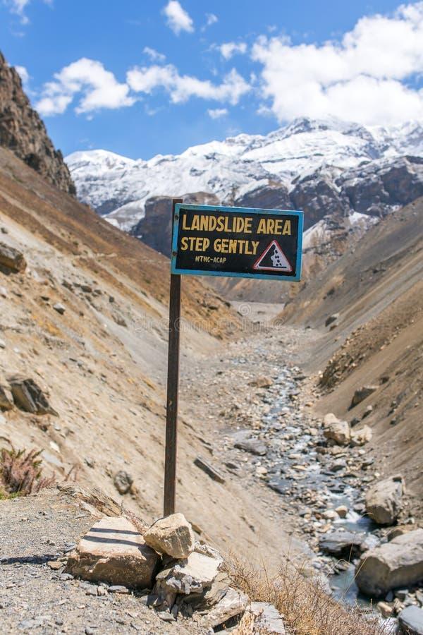 Landslide prone area sign on Annapurna circuit trek royalty free stock photos