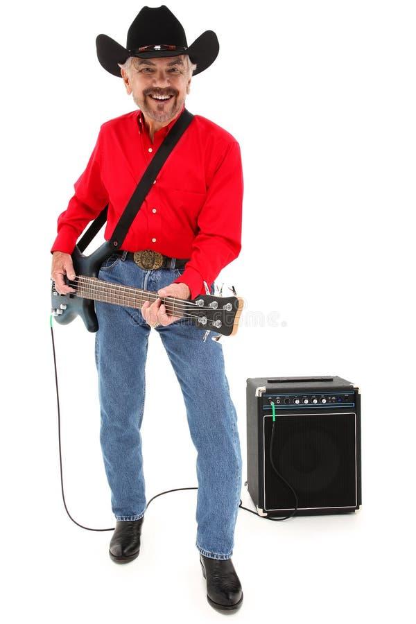 Landsmusikerålder 75 med den elektriska gitarren royaltyfria foton