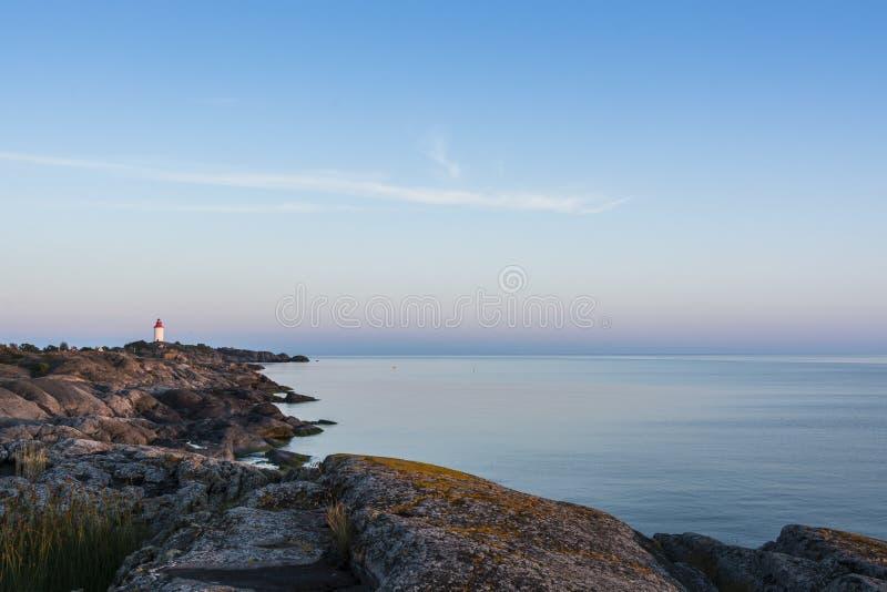 Landsort historic lighthouse Stockholm archipelago. Landsort historic lighthouse on the cliffs of Landsort in the southermoust part of Stockholm archipelago with royalty free stock image