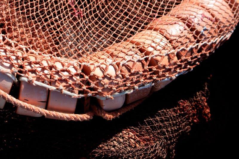 Landstreicher und Fischernetz stockbild