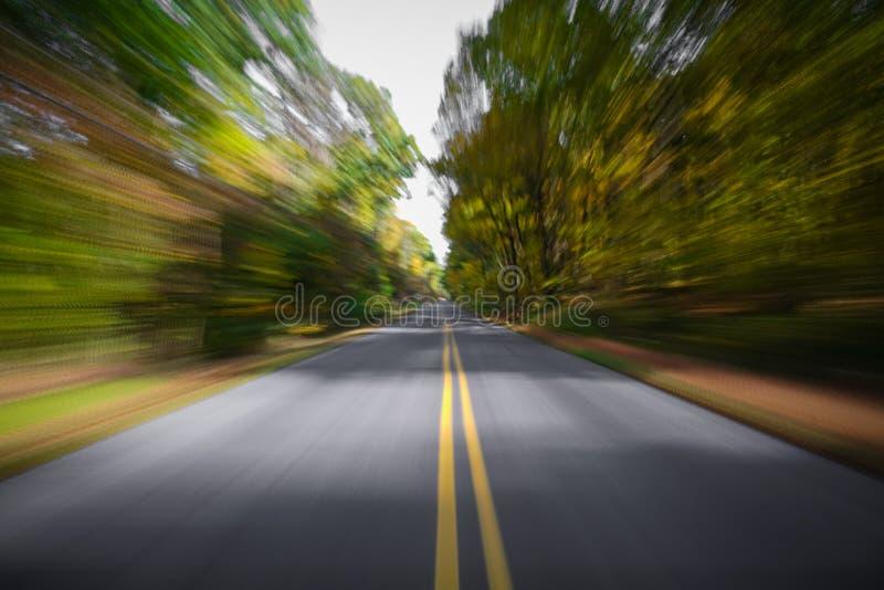 Landweg in de herfst met motieonduidelijk beeld royalty-vrije stock foto's