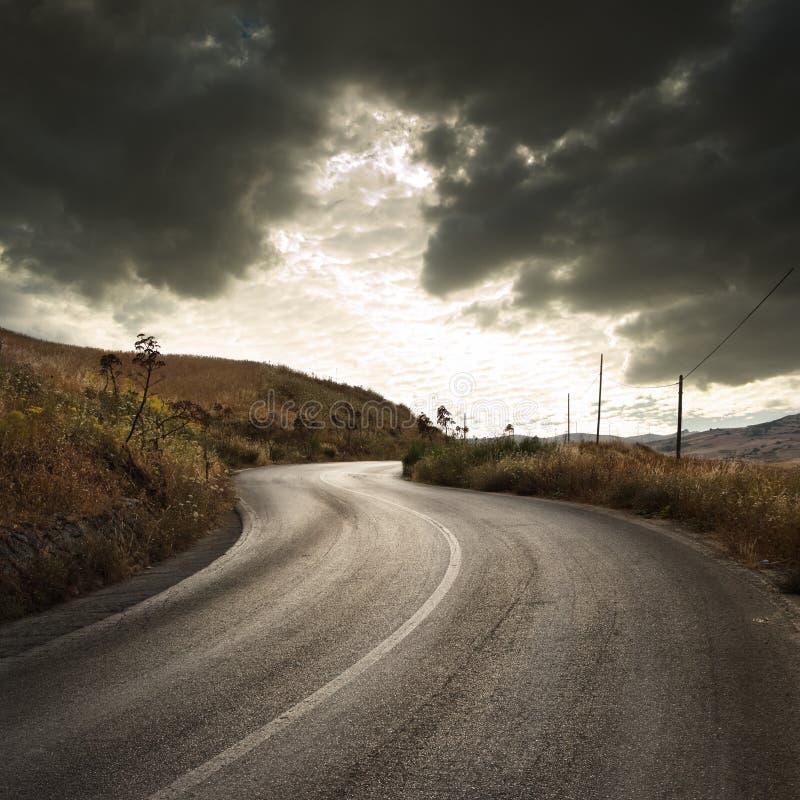 Landweg in Zonsondergang royalty-vrije stock foto's