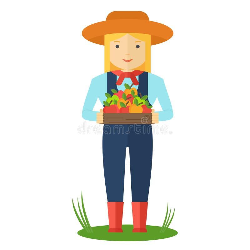 Landwirtfrau mit Kasten des Farbapfels lizenzfreie abbildung