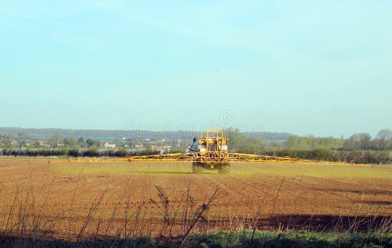 Landwirtschaft-Traktorsprühernten. stockbild