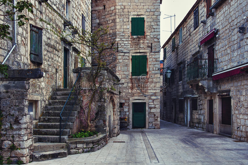 Lane in Stari Grad. Narrow alley with old houses in Stari Grad stock photos