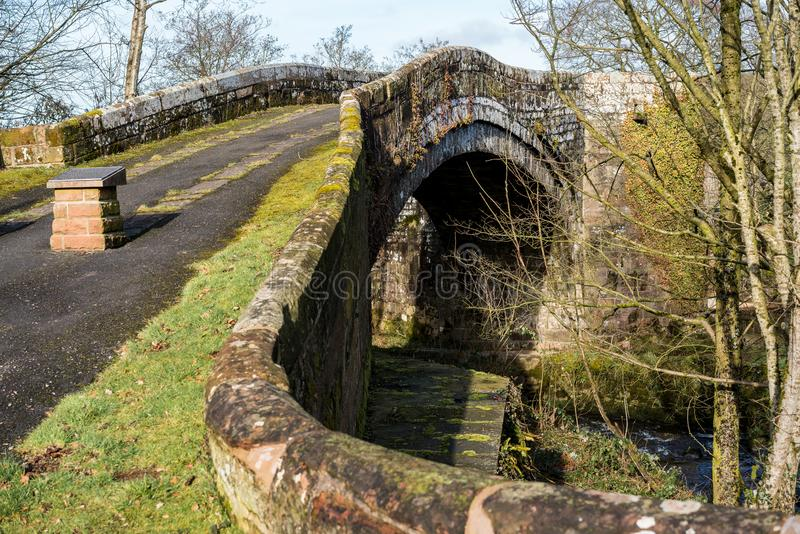 Lanercost Bridge. The bridge was constructed around 1724 ad replacing earlier bridges swept away by floods. Lanercost Priory is nearby which was founded by royalty free stock photo