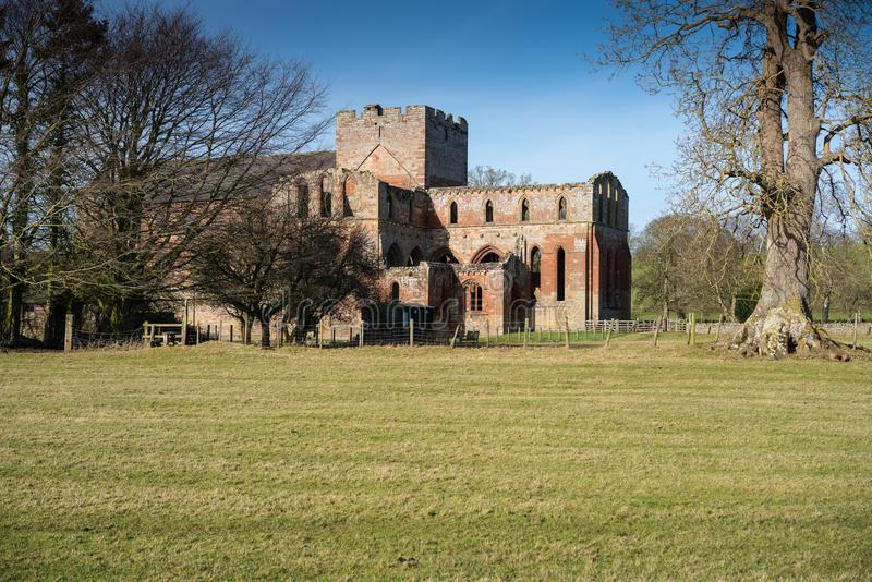 Lanercost Priory. Was founded by Robert de Vaux between 1165 and 1174, to house Augustinian Canons. It is situated at the village of Lanercost, Cumbria, England stock photography