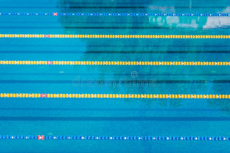 Lanes in a competition olympic size outdoor swimming pool. Calm Water background. Lanes in a competition olympic size outdoor swimming pool. Calm Water royalty free stock photography